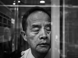 Hard knock life of a security guard, Tsim Sha Tsui East - Hong Kong | by adde adesokan