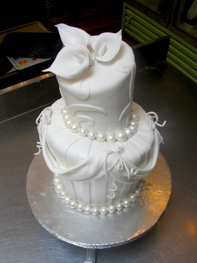 2-tier Mad Hatter wedding cake covered in white fondant de… | Flickr