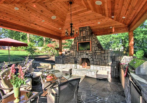Exquisite stone fireplace by paradise restored landscaping for Exquisite stone
