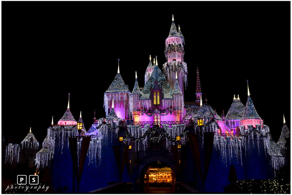 disney castle christmas night by vision unlimited