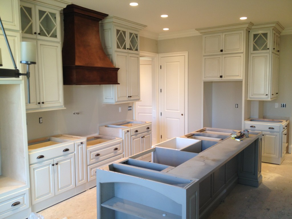 ... Kitchen Installed With Antique White Cabinets And Copper Range Hood In  A Custom Home By Louisville