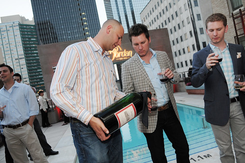Assistant Winemaker Ronald Du Preez pours six liter of 1979 Jordan Cabernet for Bryan and Taber Wetz of RISING Gallery - Jordan Winery 40th anniversary party at The Joule Hotel | by jordanwinery.com