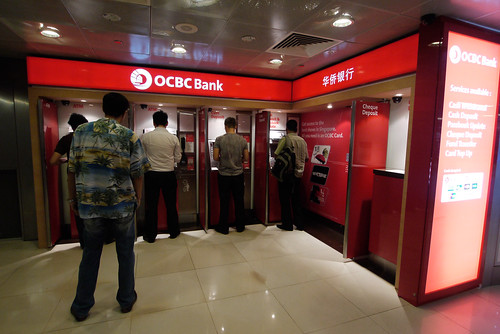 An OCBC ATM services customers at the Raffles Place MRT station on 12 August 2011. There are currently 6 local and 106 foreign banks operating in Singapore. | by Asian Development Bank