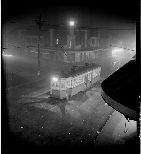 Night fog, Chatswood  tram, July 1950, from Series 02: Sydney people & streets, 1948-1950, photographed by Brian Bird | by State Library of New South Wales collection