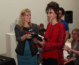 Lisa Mattson of Jordan Winery presents People's Choice award winner Kremena Ivanova with a magnum of Jordan Cabernet Sauvignon at Jordan Winery's 4 on 4 Art Competition at Hadid Gallery on April 11 | by 4on4Art