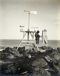 Dr Simpson taking meteorological observations at the station on Vane Hill, Cape Evans | by Met Office
