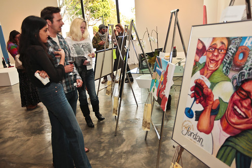 Guests view artwork at Jordan Winery's 4 on 4 Art Competition at Hadid Gallery on April 11 | by 4on4Art