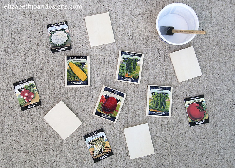 Mod Podge Paper Onto Wood to create Vintage Seed Packet Markers for your garden