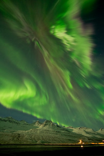 Galerry An aurora on March 8 2012 shimmering over snow covered mountains in