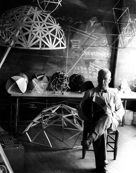 Buckminster Fuller at his Black Mountain College studio with models of geodesic domes, 1949.