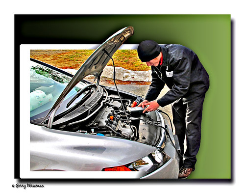 AAA Mechanic checking our engine | by Gerwise