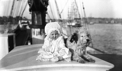 Baby and a dog on a sailing ship | by Australian National Maritime Museum on The Commons