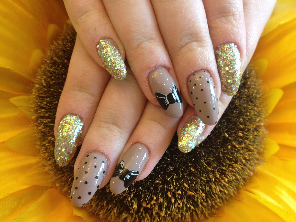 Acrylic nails almond shape with gel polish, glitter and no… | Flickr