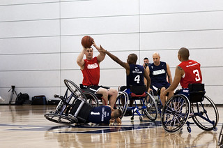 A Sgt. prepares to pass the ball during a wheelchair basketball game between the Marine Corps and the Navy/Coast Guard at the 2012 Warrior Games. | by Official U.S. Navy Imagery