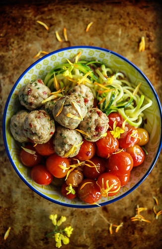 Zoodles with blistered tomatoes and mini sundried tomato chicken meatballs- paleo from HeatherChristo.com | by Heather Christo
