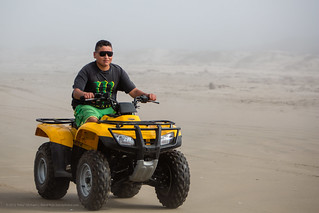 male youth drives an illegal Off Road Vehicle (ORV) All Terrain Vehicle (ATV) on beach | by mikebaird