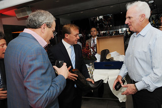 Shelly Stein and Bennett Glazer of Glazers Distributors present John Jordan with a birthday gift (Lucchese boots) at Jordan Winery's 40th anniversary party at The Joule Hotel | by jordanwinery.com