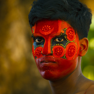 Man With Traditional Makeup On His Face For Theyyam Ceremony, Thalassery, India | by Eric Lafforgue