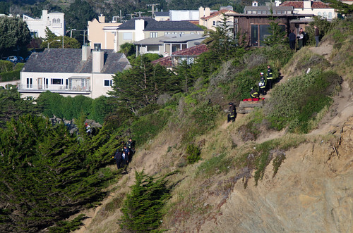 SFFD and Rescue Climbers on the side of the Sea Cliff | by morozgrafix