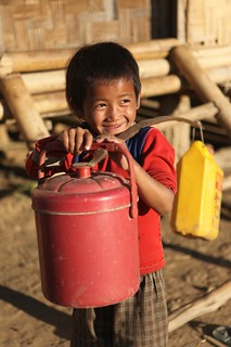 Boy from rural community on his way to collect water in Pha Oudom, Laos | by Plan Asia