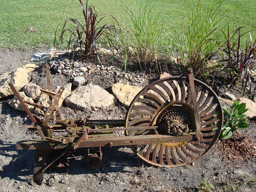 neighbor's scrap, my yard art. We think an old seed planter | by madp04