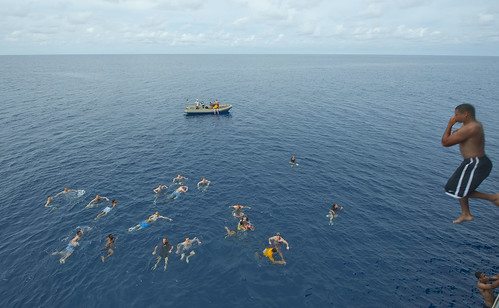 Sailors participate in a swim call after a Crossing the Line ceremony. | by Official U.S. Navy Imagery