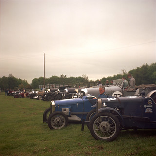 Vintage cars lined up in the paddock | by Julian Dyer
