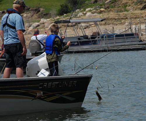 Fish camp 6 braedon mcdonald reeling in his catch at the for Lake sakakawea fishing