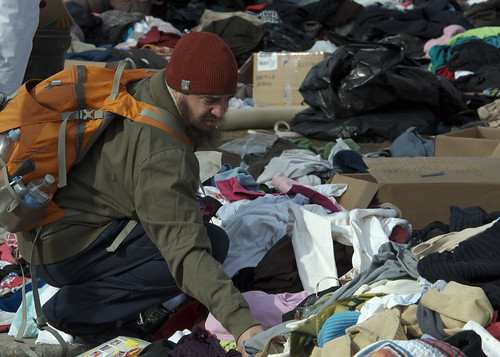 Displaced civilian searches for clothing. [Image 7 of 9] | by DVIDSHUB