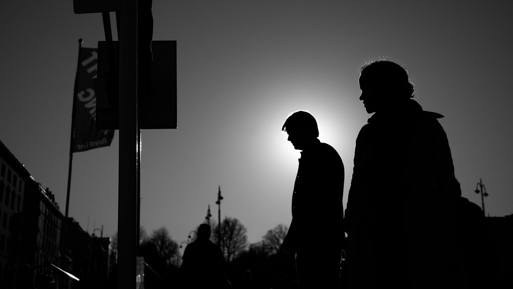 Man And Woman In Backlight