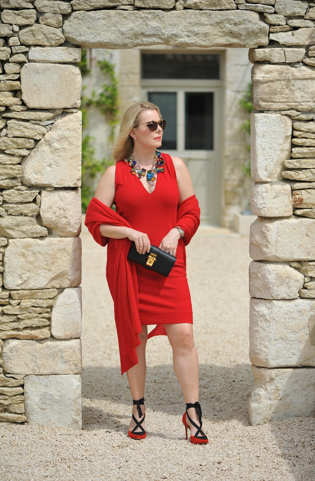 The Sequinist in Winser London | Red jersey dress, statement necklace, fierce heels