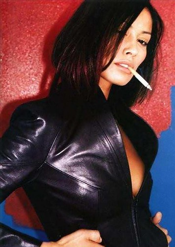 Hot woman smoking in full leather outfit 6