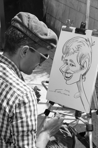 Caricature artist working in the square. | by Seaton Carew.