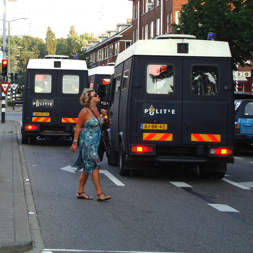 Lady between riot trucks | by davidvankeulen