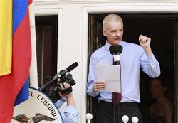 Julian Assange of WikiLeaks speaks at a press conference from the balcony of the Ecuadoran embassy in London. Assange has been granted political asylum by Ecuador. | by Pan-African News Wire File Photos