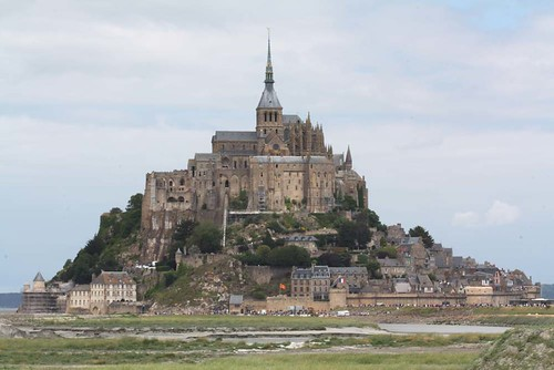 Le Mont Saint-Michel on the border between Normandy and Brittany with a monastry and village within its protective walls. | by Shandchem