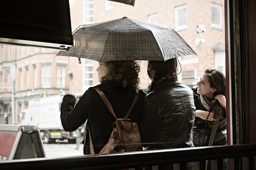 Young women with an umbrella during a shower seen from inside a restaurant in Dublin - Temple Bar quarter - Ireland | by PascalBo