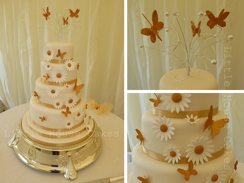 Gold butterflies and daisies wedding cake | 4"|796|600|?|en|2|c7f7df122c7db09a48191f077a37968c|False|UNLIKELY|0.3785881996154785