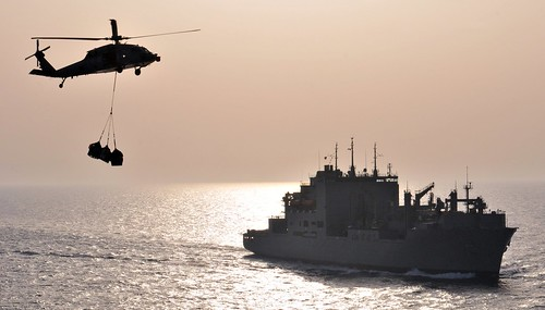 An MH-60S Sea Hawk helicopter transports supplies. | by Official U.S. Navy Imagery