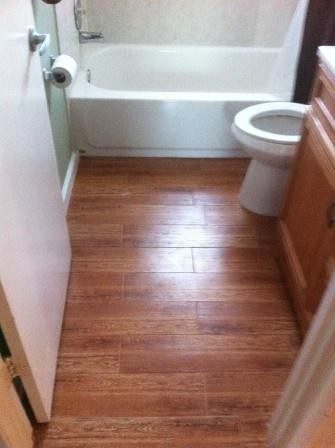 ceramic tile hardwood look installation | by HandymanMattersClearwater