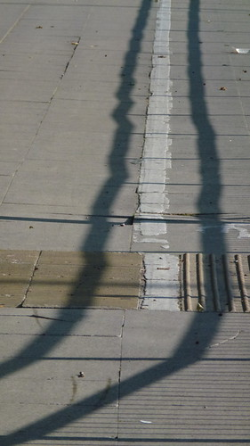 Shadows and light on pavement beside Princess Road in Hulme, Manchester, UK | by Alex Pepperhill