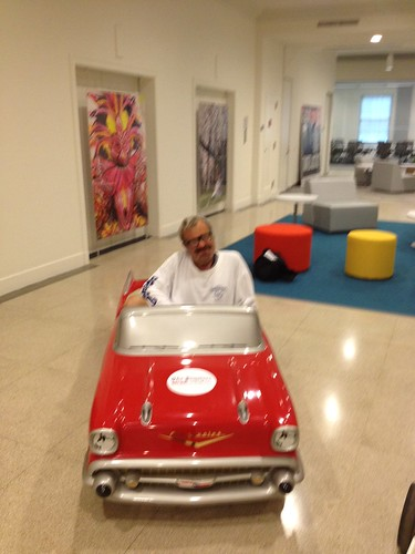 "Daily News stats legend Thomas ""Hockey Puck"" McKenna checks out the car in the lobby of the new office!! 