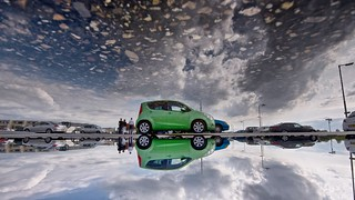 little green car in a big cloudy puddle | by Cybergabi