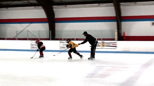 Brad Perry challenging a player during a hockey school in Chicago | by Brad Perry
