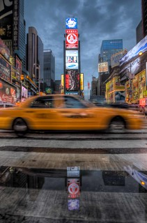 taxi in times square | by Paul Cowell