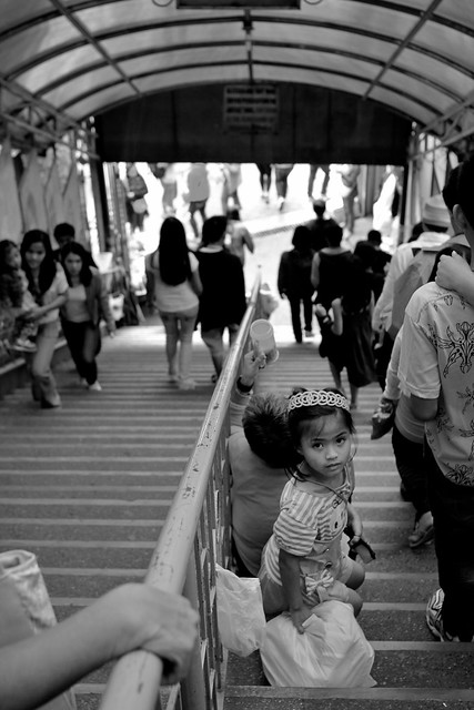 Girl along staircase