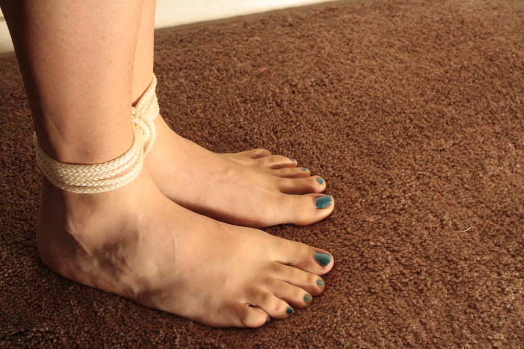 Feet tied over head self bondage
