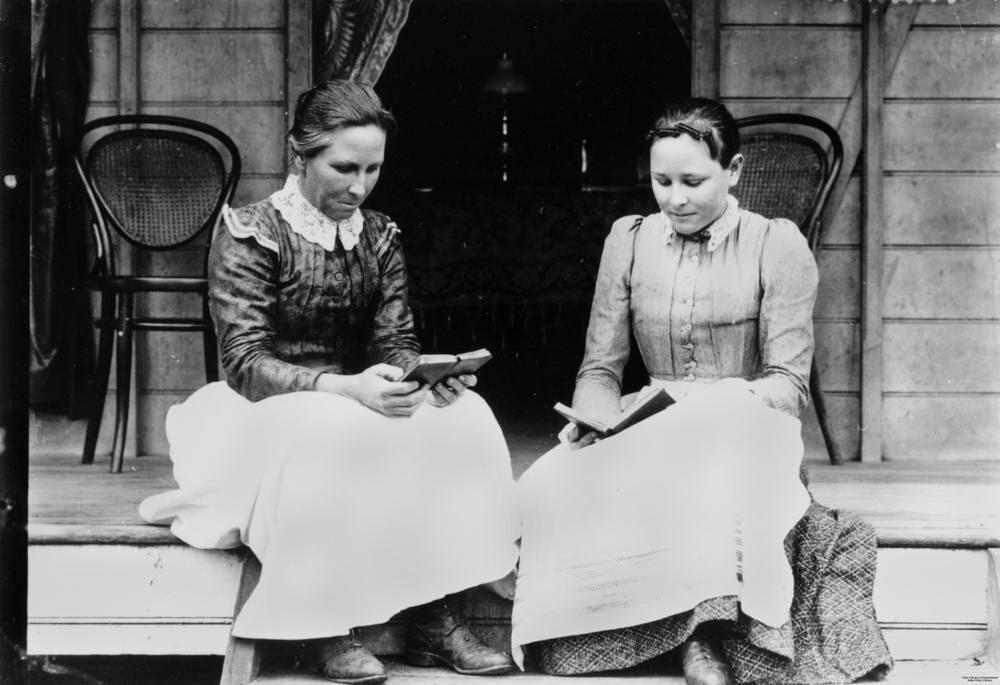 two women reading on a verandah at ingham ca 1894 1903 flickr