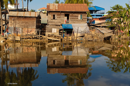 Shanty town reflection - Siem Reap, Cambodia | by Phil Marion