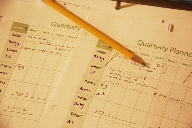 planner pages with pencil